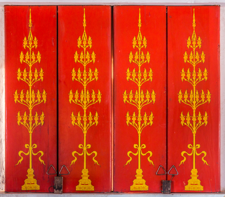buddhist temple: Vintage painting design on ancient wooden windows. The windows of Buddhist temple is at Wat Nong Waeng in Khon Kaen province, Thailand.