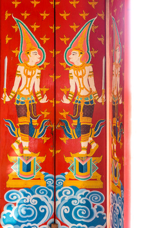 wat: Vintage deity painting design on ancient wooden doors. The door entrance of Buddhist temple is at Wat Nong Waeng in Khon Kaen province, Thailand.