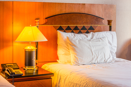 cordiality: Romantic bed room for relaxation. The room is in hotel room.