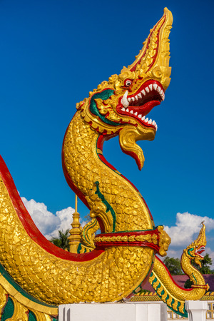 deity: The religion art of Naga statue in Thailand Buddhist temple. Naga is a serpent deity in Hindu and Buddhist mythology. Stock Photo