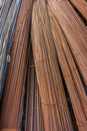 round rods: Rusty steel rods. They are used for construction work. Stock Photo