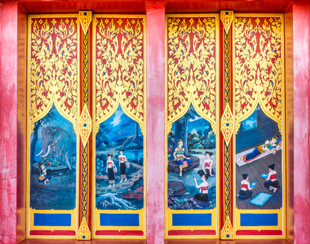 Vintage painting design on ancient wooden doors. The door entrance of Buddhist temple is at Wat Nong Waeng in Khon Kaen province, Thailand.
