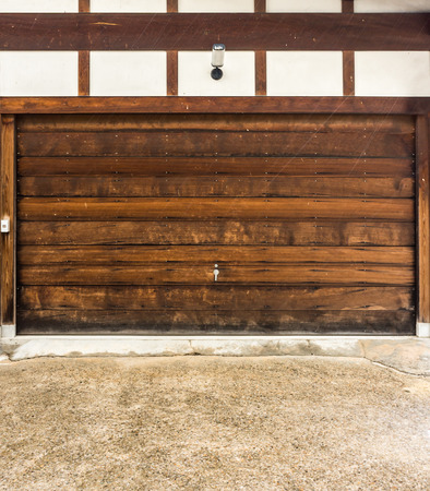 storeroom: The wooden gate of storeroom of a vintage house.  A part of a building room for storing things or vehicles