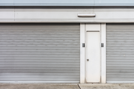 lockout: The steel doors of factory. There are panel and rolling doors. Stock Photo