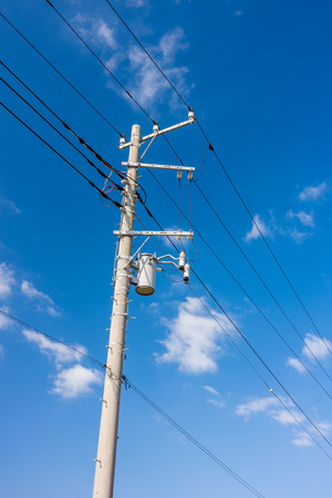 Electrical power line cables and  concrete pole with transformer. The power system in Japan, Asia.