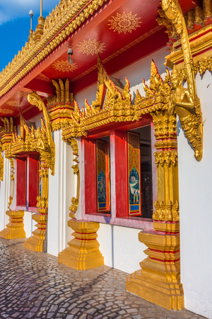 wat: The religion art of vintage temple windows and wall. The art of Buddhist temple at Wat Nong Waeng in Khon Kaen province, Thailand, Southeast Asia. Stock Photo