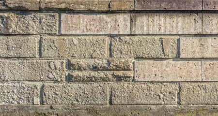 constructed: Vintage old cracked wall. It is constructed with big brick block. Stock Photo