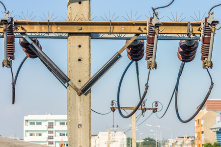 three phase: Closeup of overhead electric power transmission and distribution lines. It is power line system in Thailand. Stock Photo