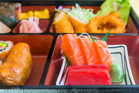 lacquerware: Food replicas of sashimi in Bento set. The model of Japanese delicacy.