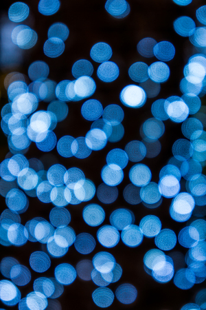 dreamlike: Abstract blue bokeh light isolated with black  background. It is used for background and pattern. Stock Photo