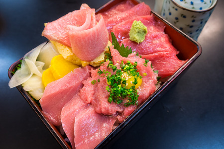 japanese quail: Bento of mixed Sashimi topped with quail eggs. It is a Japanese delicacy.