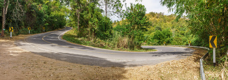 sharp curve: Panoramic view of road curve on mountain. The sharp curve is in tropical forest of Thailand.