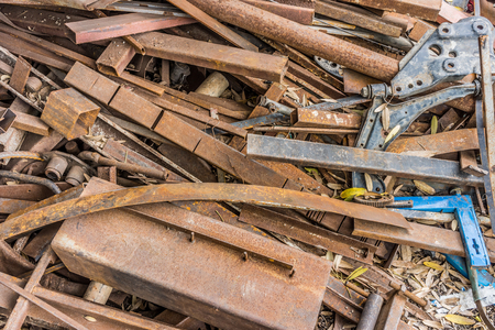 rustiness: Garbage dump of waste metals. The rusty irons and steels are waiting for reuse.