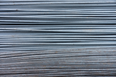 reinforcing: Pile of iron wires and deformed  reinforcing bars. They are reinforcement steel materials in reinforced masonry structures.