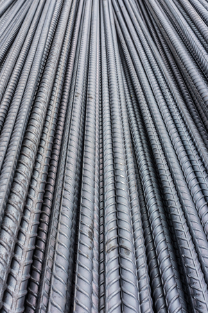 round rods: Pile of deformed  reinforcing bars. They are reinforcement steel materials in reinforced masonry structures.