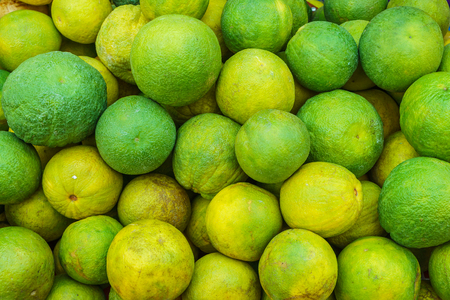citrus aurantium: Pile of Citrus aurantium for sale in Thailand market. It is a hybrid Citrus.