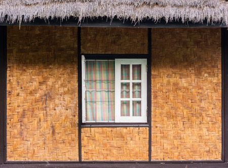 thatched roof: Vintage wooden window, twill weave wall and thatched roof. The traditional home design in Thailand, Asia.