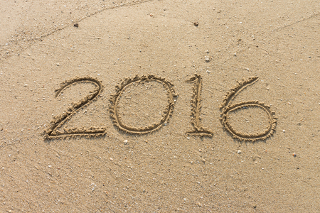 Number of year 2016 on sand. It is writed on beach.
