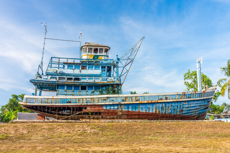 Blue abandoned fishing boat ruin in Phang Nga, Thailand. It was damaged in the last tsunami.