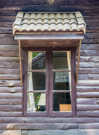 overhang: Classic glass window with roof. The old house in Thailand.