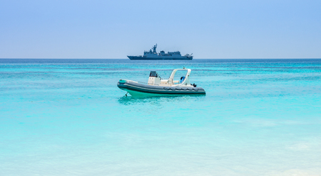 battleship: Floating military speed patrol cruiser boat and warship with helicopter. Seascape view in Andaman sea, Southeast Asia.