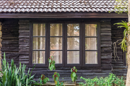 Retro wooden window and wall. The old house in Thailand.