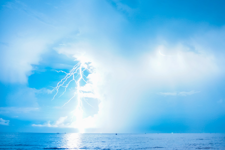 Thunderbolt and lightning strike at midnight. A thunderstorm over gulf of Thailand. Stock Photo
