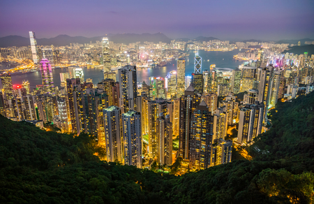 Night light cityscape of Central District, Hong Kong. Scenery aerial view from the peak mountain.