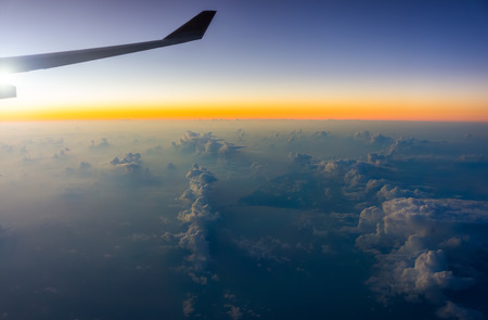 fixed line: Sky view with skyline and cloud. Travel and transportation by airplane. Stock Photo