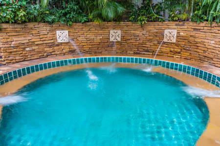 Outdoor built-in jets spa pool. It is used for relaxation, hydrotherapy, warmth, and entertaining.