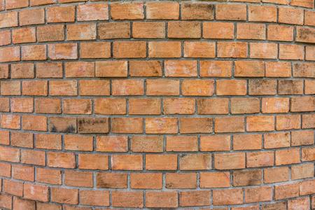 Round brick wall. All bricks in this bond are stretchers. Stock Photo