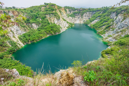 Scenery view of emerald pond at Grand Canyon Khiri in Thailand. It originated from substances dissolved in water in old abandoned mine.