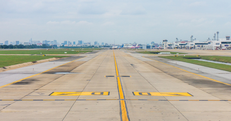 Panorama of airplanes on taxiway in airport. Path for aircraft transfer to and from runway. Stock Photo