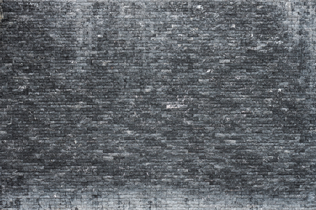 White-stained black brick wall. For using as background and texture.