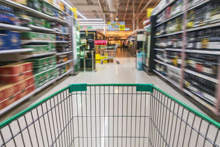 Shopping cart in beverage department. It is also known as trolley or wheeled cart. Stock Photo