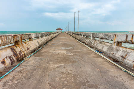 Old grunge concrete pier at Thung Wua Laen beach. It is in Chumphon province, Southern Thailand.