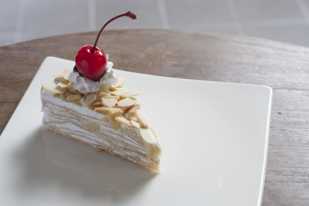 Almond Crepe Cake and Red Cherry On The Top Stock Photo - 17123059