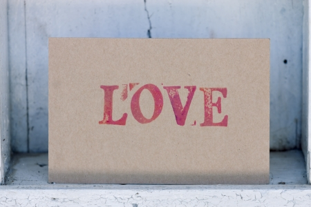 Handmade love card  on White vintage shelf photo