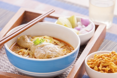 khao soi curry noodle northern thai traditional food. photo