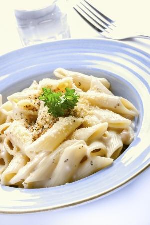 Penne pasta cream sauce and cheese  Фото со стока