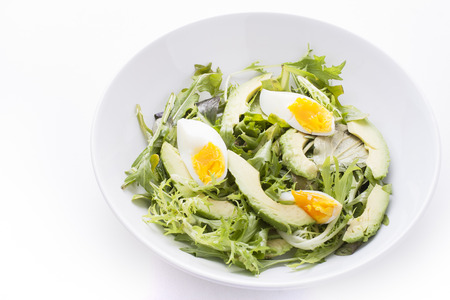 Avocado salad with boiled eggs photo