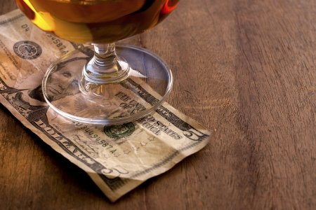 tipping: Tip Money on the wooden counter Stock Photo