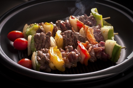 Grilling skewers barbecue with meat and vegetables on electric grill  photo