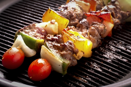 Grilling skewers barbecue with meat and vegetables on electric grill. photo
