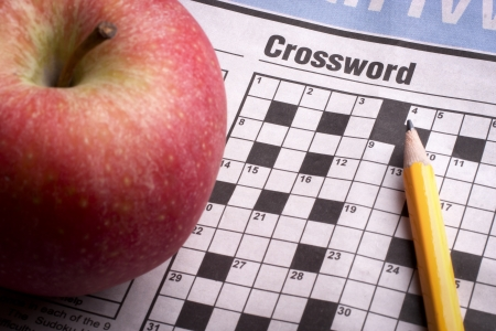 Crossword Puzzle game in  the newspaper Stock Photo