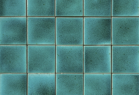Turquoise ceramic wall tiles and details of surface Фото со стока