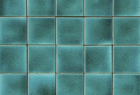 Turquoise keramische wandtegels en de details van het oppervlak