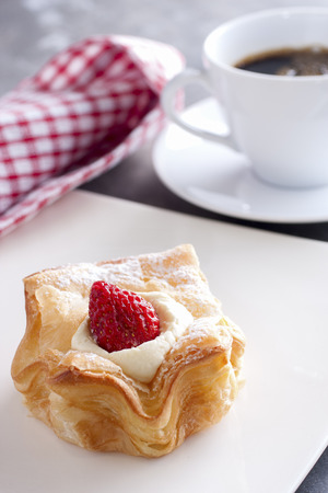 Strawberry Puff Served on a white plate with black coffee  photo