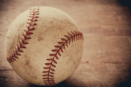 Old baseball on wooden background and highly closeup Фото со стока