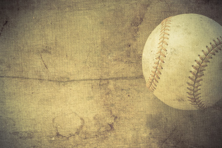 Old baseball on wooden background and copy space  photo